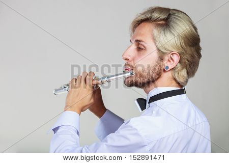 Male Flutist Playing His Flute