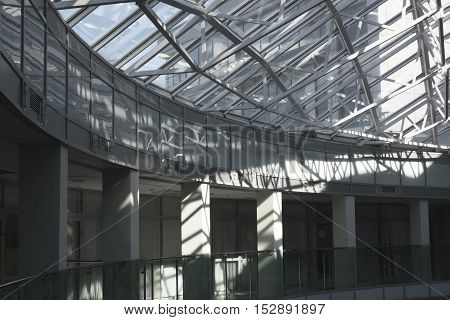 A part of glass roof and sunlit pillars