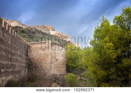 Medieval walls of the Castle of Sagunto before the rain, Spain