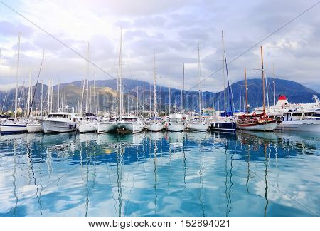 Luxury White Yachts On Blue Water