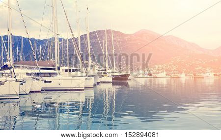 White Sailing Boats At The Sunset