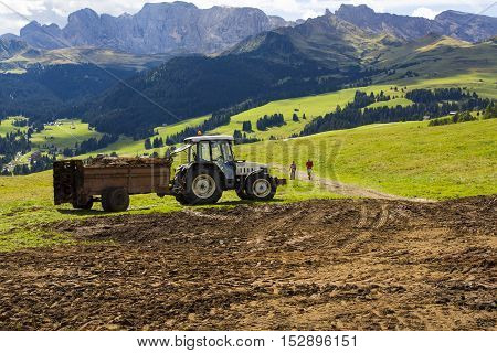 View of an agricultural tractor at work on a sunny day
