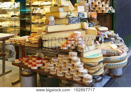 LONDON UNITED KINGDOM - NOVEMBER 20: Cheese shop in London on NOVEMBER 20 2013. A Variety of Cheeses for Sale at Borough Market in London United Kingdom.