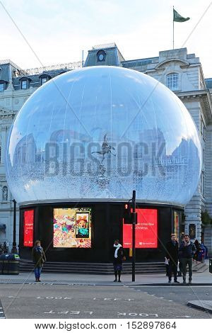 LONDON UNITED KINGDOM - NOVEMBER 21: Eros Statue in Snow Globe London on NOVEMBER 21 2013. The Statue of Eros in Giant Snow Globe at Piccadilly Circus in London United Kingdom.