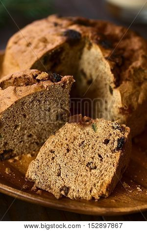 Traditional Chilean Pan de Pascua Christmas Cake made with spices dried fruits and raisins photographed with natural light (Selective Focus Focus diagonally through the slice in the front)