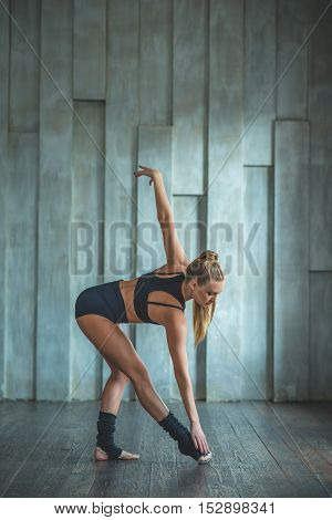 Perfect technique. Vertical shot of young flexible woman dancing contemporary dance in studio