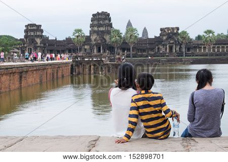 SIEM REAPCAMBODIA-OCT 14 : Tourist was relaxing at edge of moat of Angkor Wat October 142016Siem ReapCambodia.