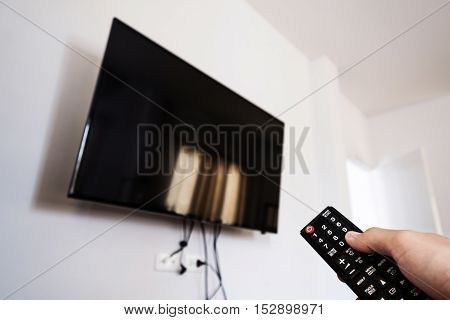 Watching Television , Hand using remote TV
