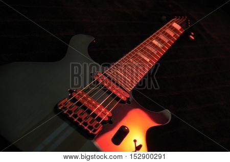 Teal color electric guitar with red light