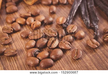 Vintage Photo, Fragrant Vanilla And Coffee Grains On Wooden Surface
