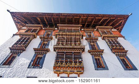the main tower for prayer with asian art window and roof at Paro Dzong Bhutan