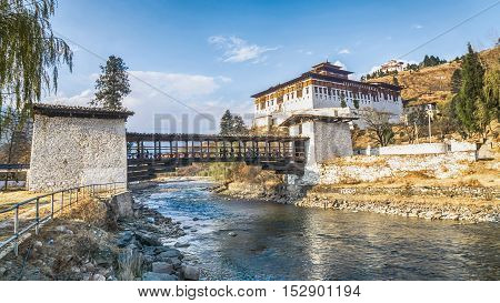 The bridge across the river with traditional bhutan palace Paro Rinpung Dzong Bhutan