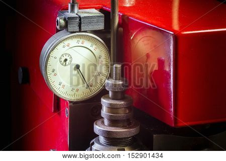 Close view dial indicator distance meter on a red key copying machine