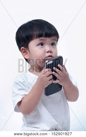 boy playing in a mobile phone on white background.