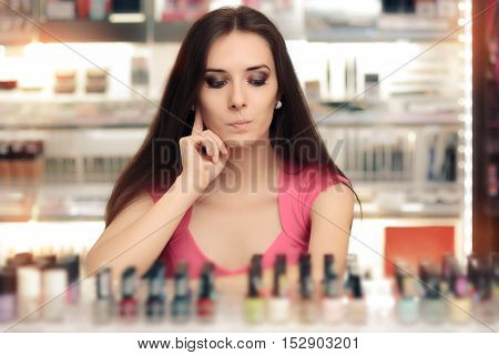 Cute Girl Choosing Between Bottles of Nail Polish