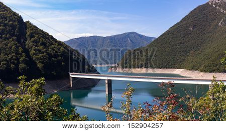 Bridge over the Piva lake azure color on a sunny day