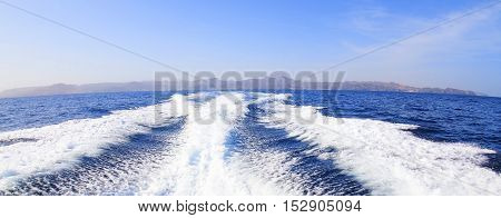 Panorama view of land sea and water stream after speed boat