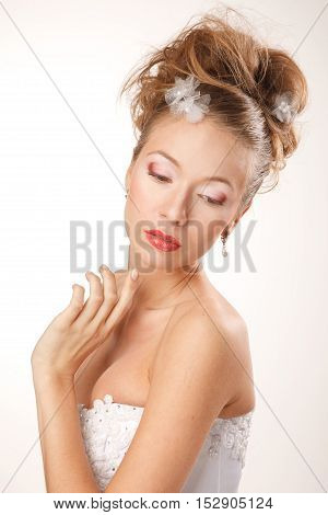 Bride is looking down and holding her hand near face