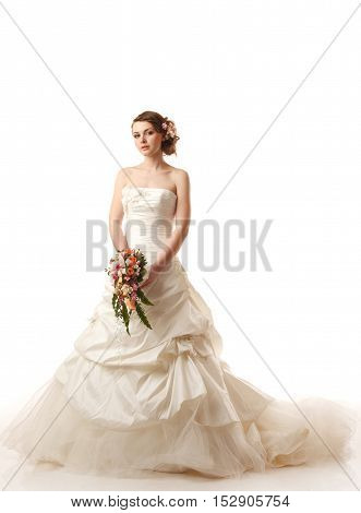 Charming bride looking at camera.Modern hairstyle with real flowers