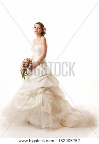 Bride with bouquet. Classical hairstyle with flowers