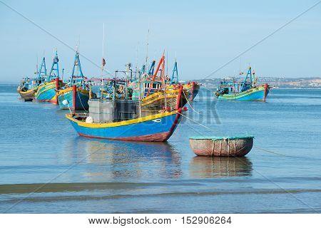 MUI NE, VIETNAM - DECEMBER 25, 2015: Fishing schooner in the harbor of Mui Ne village. Tourist landmark