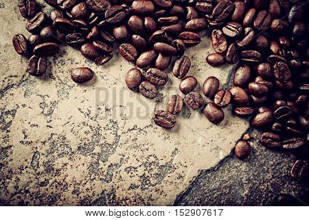 Coffee beans on a stone background