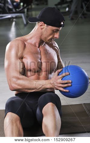 Handsome Powerful Athletic Man Performing Abs Exercise With Medicine Ball. Strong Bodybuilder With P