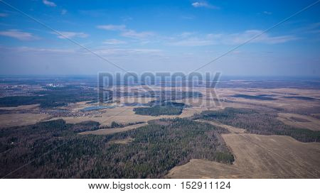 aerial landscape area of fields and forests