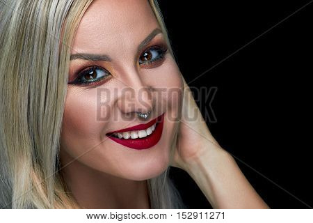 Beautiful woman red lips portrait healthy skin, with bright makeup, studio photo