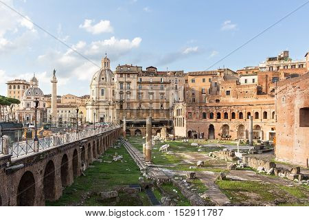 Roman forum ancient ruins in Rome with view on Trajan column, Italy