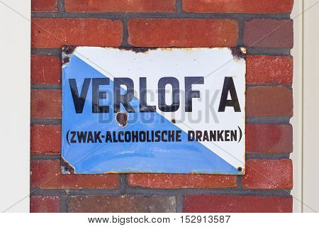 LELYSTAD THE NETHERLANDS - JUNE 9 2016: Old permit (Verlof A) outside of a dutch bar. With this permit a bar could serve alcohol.
