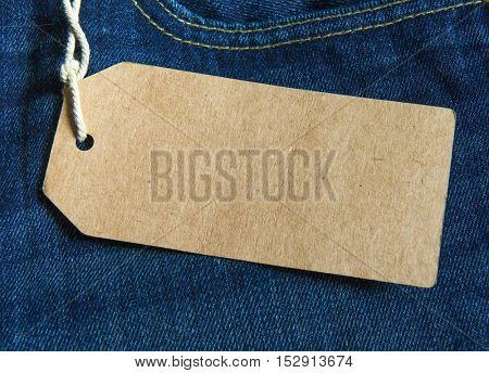 Blue jeans detail with blank tag.