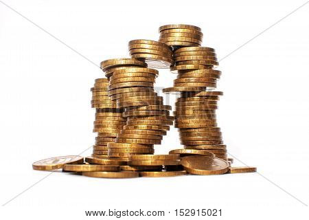 Stacks of coins. Money. Gold. Coins on a white background. Tower of money.