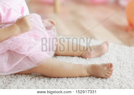 Legs of little baby girl closeup