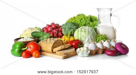 Vegetables and dairy products isolated on white