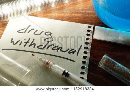 Drug withdrawal written on a paper.  Addiction concept.