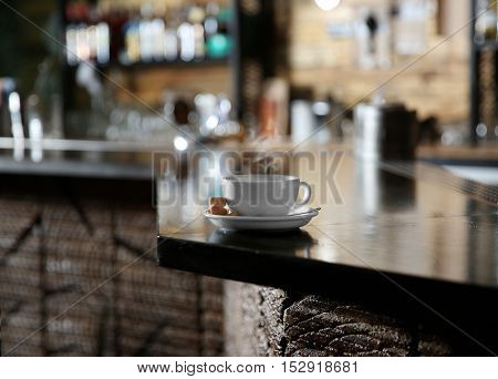 Cup of coffee on bar counter