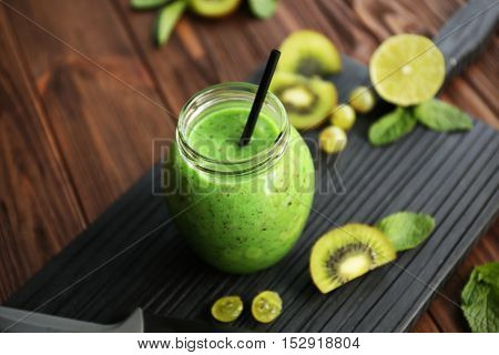 Refreshing fruit smoothie on table