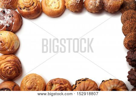 Frame of assorted fresh pastries on white background