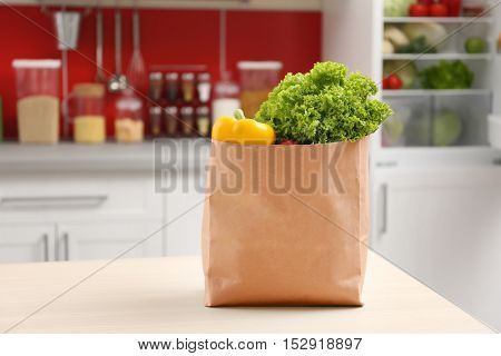 Bag with vegetables in kitchen