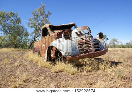 Old rusty car in outback paddock Australia