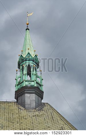 Church Bell Tower over the Cloudy Sky