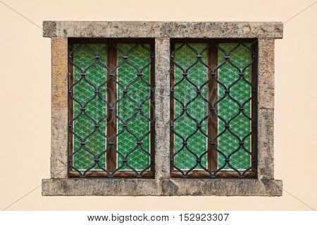 Two Barred Windows of Yellow Old House