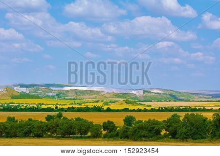 Fields in Bulgaria under the Cloudy Sky