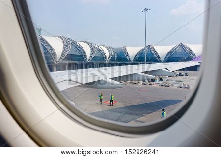 BANGKOK - APRIL 22: Suvarnabhumi Airport is one of two international airports serving Bangkok on April 22 2016 in Bangkok Thailand. View through the window.