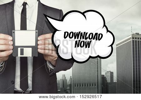 Download now text on speech bubble with businessman holding diskette
