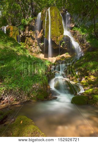 One of many Soptnica waterfalls hidden in woods at beautiful sunny day. Travel and tourist destination in Serbia.