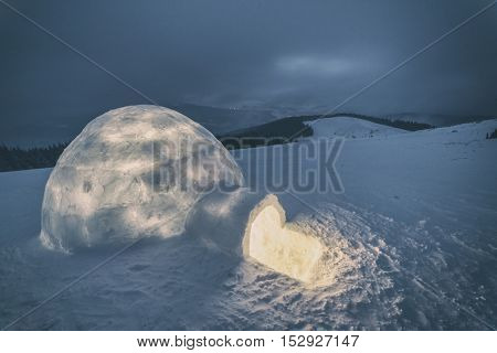 igloo in the high mountain, toned like Instagram filter