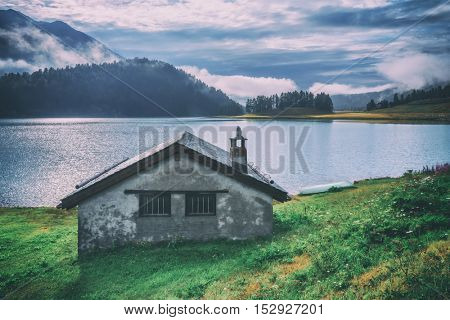 Amazing sunny morning at Champferersee lake in the Swiss Alps. Silvaplana village, Switzerland, Europe. Toned like Instagram filter