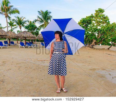 Brunette Woman With A Beach Umbrella